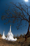 New white pagodas in ancient temple , Myanmar. Royalty Free Stock Photography