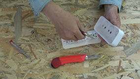 New plastic socket in electrician hands stock video footage