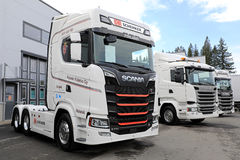 New White Scania Trucks on Asphalt Yard Stock Images