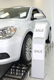 New white shining beautiful car stands on special stand Royalty Free Stock Photos