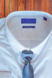 New white shirt with blue necktie Stock Images