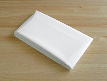 New white shower liner on wood table top Stock Images