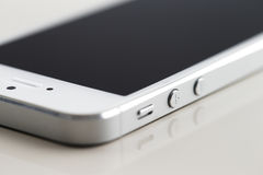 A new white smartphone on a white reflective background Royalty Free Stock Photography