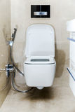 New white toilet bowl in a bathroom Stock Images