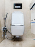 New white toilet bowl in a bathroom Royalty Free Stock Photography