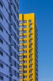 New white yellow multi-storey residential buildings. With some windows Royalty Free Stock Image