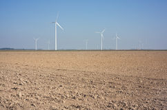 New windmills in a field. Stock Image