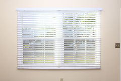 New window blinds on interior wall Stock Photos