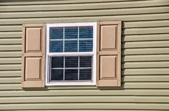 New Window On A New Home. Vinyl window and siding on a new manufactured home with shutters stock photo