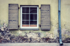 New window on old wall. Exterior of an old wall building with wooden shutters window royalty free stock images