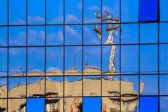 New window  reflects building Stock Photo