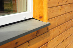 New window sill repair with house facade wooden wall exterior. House new window sill repair royalty free stock photo