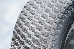 New winter car tire in snow Stock Photos