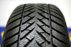 New winter tire. Closeup of the tread of a new tyre Royalty Free Stock Photos