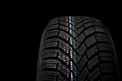 New winter tire isolated on black background Royalty Free Stock Photography