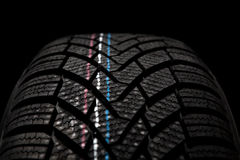New winter tire isolated on black background Royalty Free Stock Photos