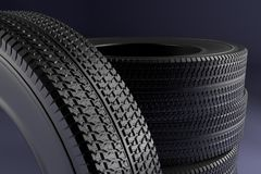 New winter tires with a modern tread on the black background. 3d high resolution image Stock Photography