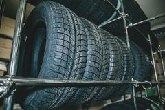 New winter tires or rubber car wheels on store shelf stock photo
