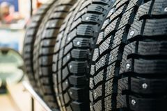 New winter tires for sale in store. Selective focus Royalty Free Stock Images