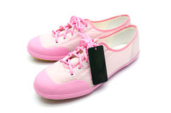 New woman pink sneaker with tag Stock Photos