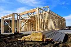 New wood frame home under construction. stock photos