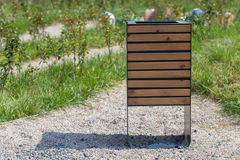 New wood trash bin in the park, save nature concept related. New trash bin in the park Royalty Free Stock Photography
