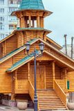 New wooden church built among high-rise buildings in the city. Of Samara stock photos