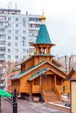 New wooden church built among high-rise buildings in the city. Of Samara royalty free stock photo