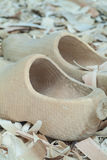 New wooden clogs on a background of wooden chips Royalty Free Stock Images