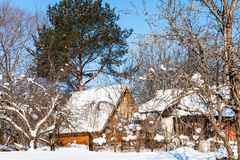 New wooden cottage in russian village in winter. New wooden cottage in russian village in sunny winter day in Smolensk region of Russia Royalty Free Stock Photography