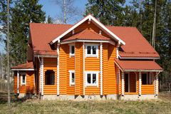 New wooden country house in forest Stock Image