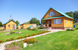 New wooden country house with outbuildings Stock Images