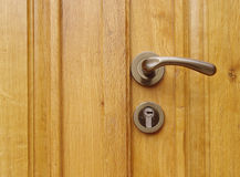 New wooden door with handle and lock Stock Photography