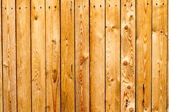 New wooden fence. Background image of new yellow wooden fence royalty free stock photography