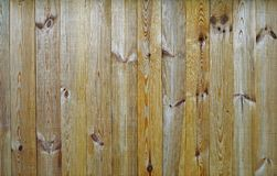 New wooden fence. Made of beige colored boards stock image