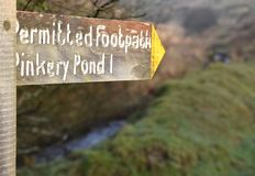New wooden footpath sign. Permitted footpath sign to Pinkery Pond. Pinkery Pond in in the Exmoor National Park, southwest England royalty free stock photography