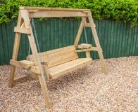 New wooden garden swing bench Stock Photo