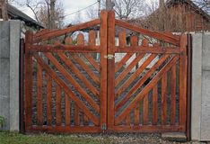 New wooden gates. Made of brown boards Stock Photo