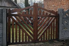 New wooden gates. Made of brown boards. Selective focus Stock Photography