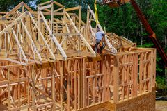 New wooden house from natural materials under construction. Close-up detail of attic roof frame construction royalty free stock photo