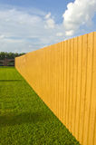 New wooden and painted fence in farm Royalty Free Stock Image