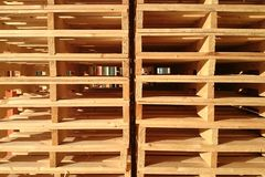 New wooden pallets is stack in the warehouse of cargo delivery e Royalty Free Stock Photography
