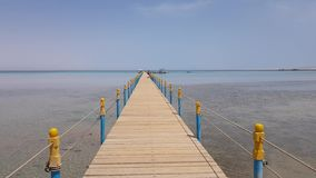 New wooden pier on the sea. boats are visible in the distance. Clear sunny day stock video