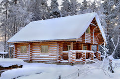 New wooden Russian sauna in a snowy winter forest, sunny day. Stock Photography