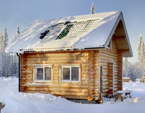 New wooden Russian sauna on a sunny winter day, the view from th Royalty Free Stock Images