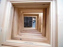 New wooden window frames arranged in a row.  royalty free stock image