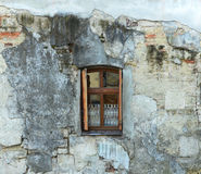 New wooden window in an old dirty wall Stock Photography