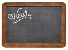 New word on blackboard Stock Photos