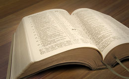 New world bible. Photo of open bible set on a wooden desk Royalty Free Stock Images