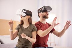 Cool attractive couple discovering virtual world royalty free stock photo